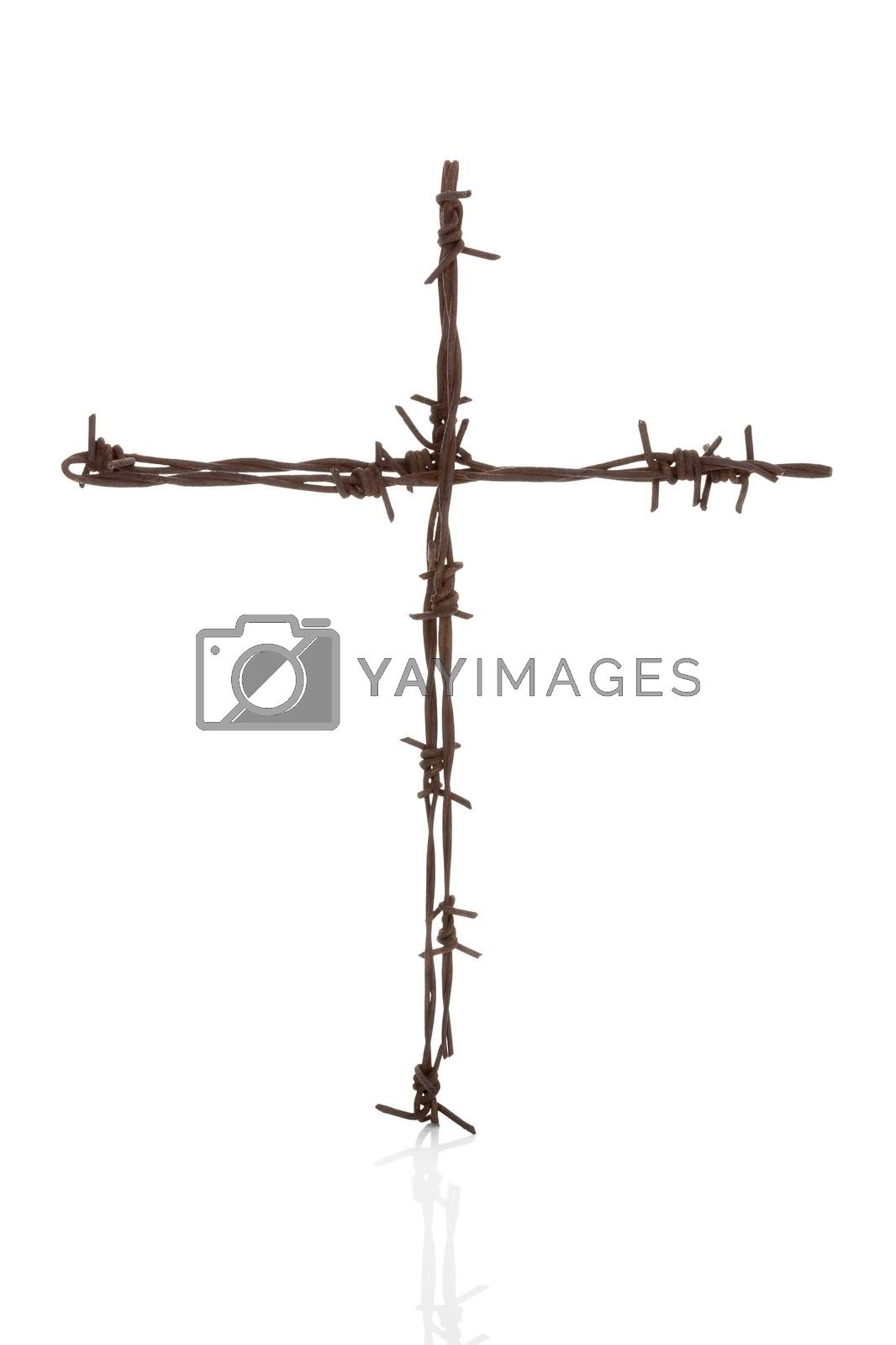 Religious war. Rusty barbwire cross isolated over white.