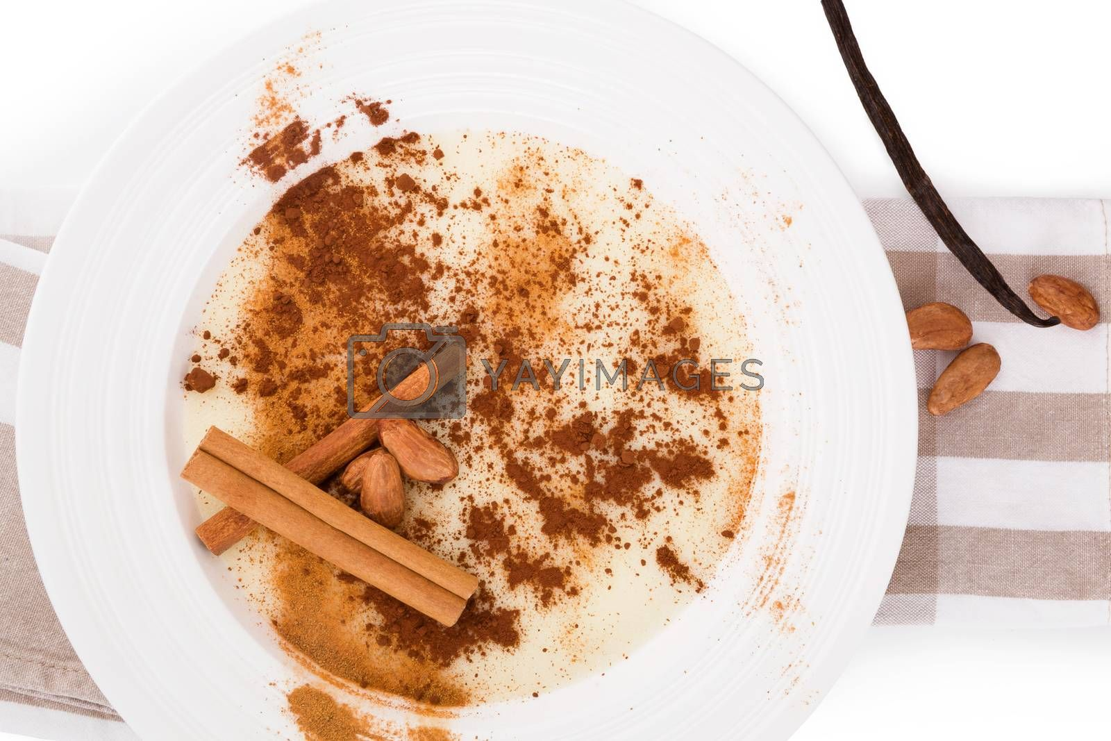 Delicious porridge breakfast with cinnamon and cocoa powder. Traditional breakfast eating.