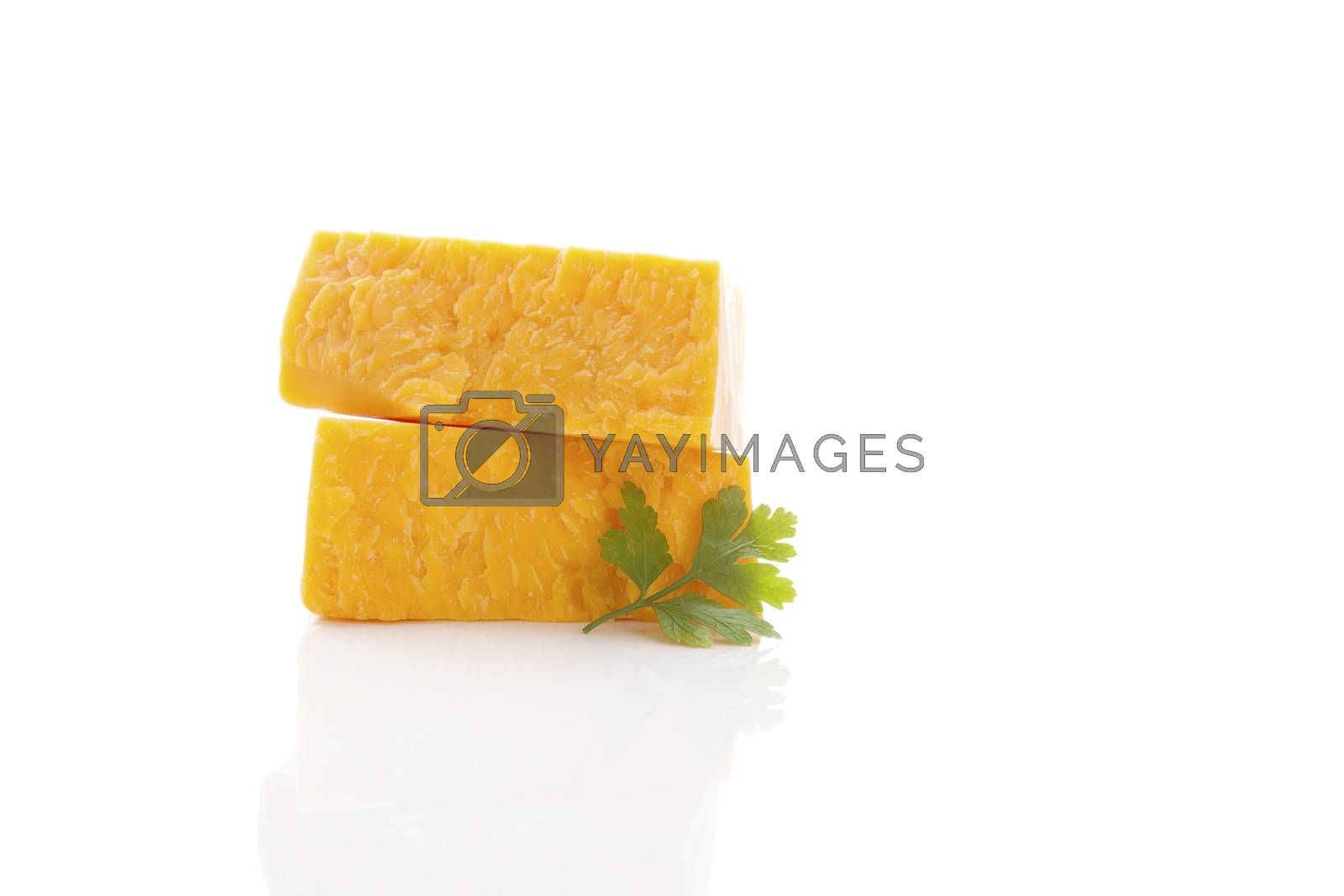 Delicious cheddar cheese isolated on white background. Culinary traditional cheese eating.