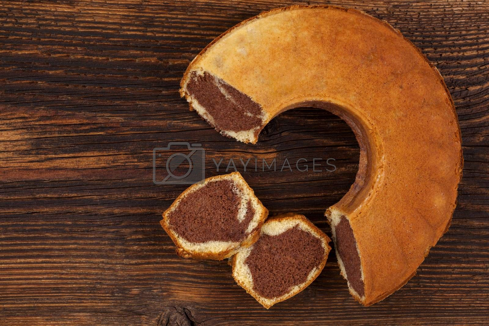 Delicious bundt cake on wooden table, top view. Traditional european sweet bundt cake.