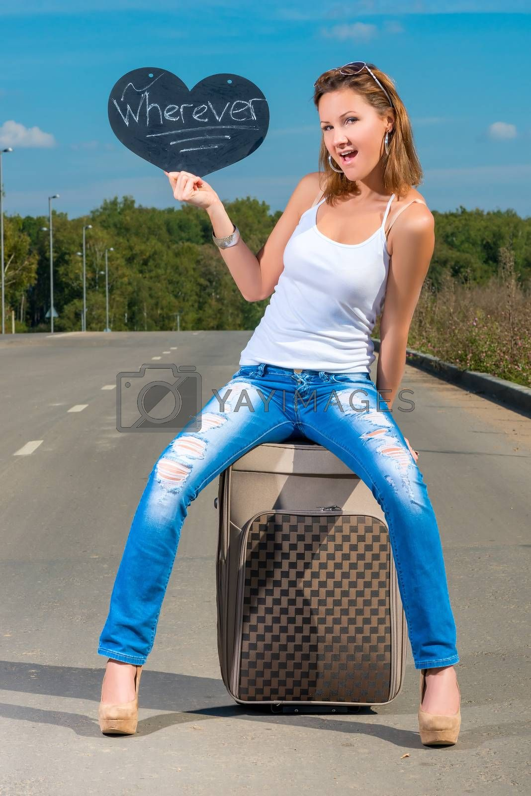 beautiful young girl with a suitcase on the road by kosmsos111