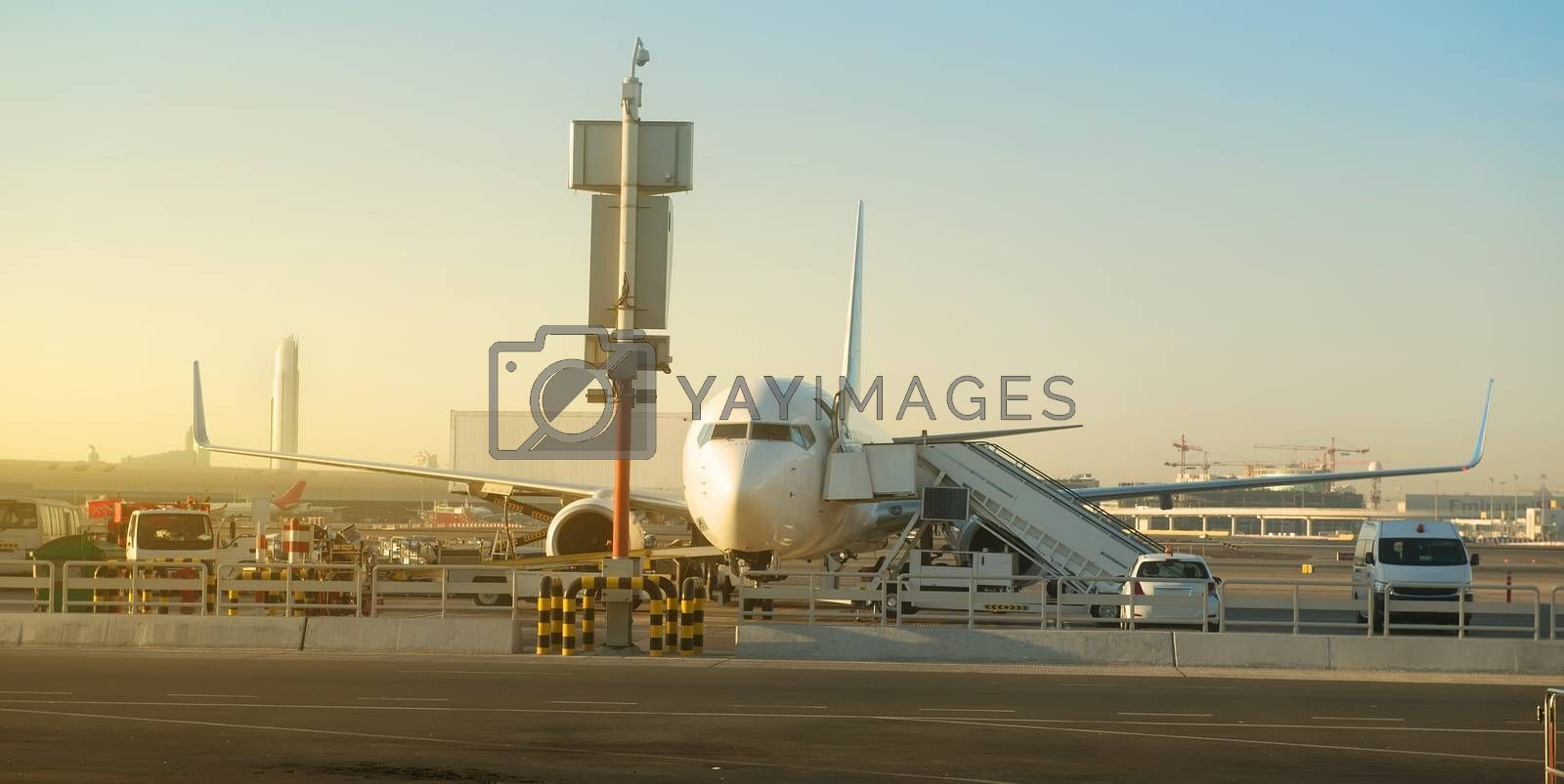Passenger plane in airport at sunny morning