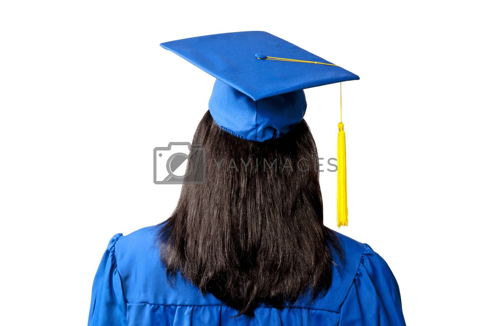 Female graduate in blue cap & gown seen from the back and isolated on white
