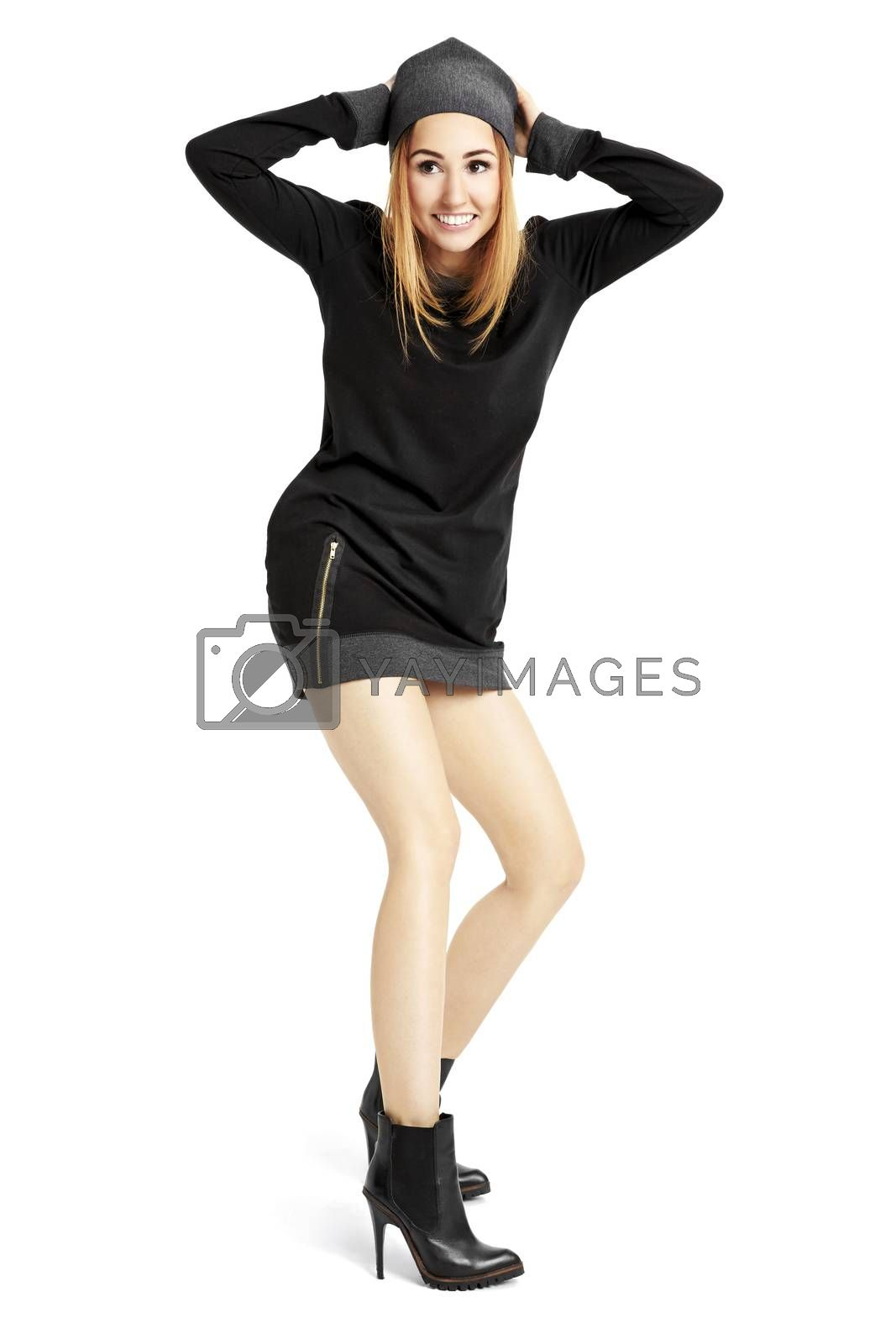 Full length portrait of young woman in a black mini dress and cap. Isolated on white background.