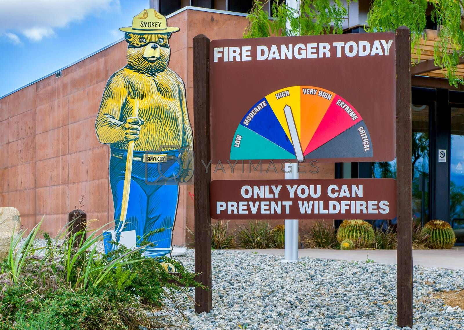 ACTON, CA/USA - MAY 7, 2016: Smokey Bear mascot and fire danger sign. Smokey the Bear is an advertising mascot to educate the public about forest fires.