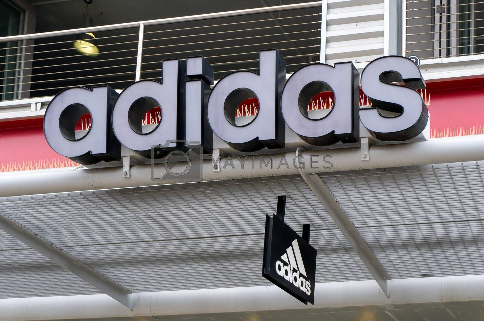 SANTA MONICA, CA/USA - MAY 12, 2016: Adidas retail store exterior and logo. Adidas is a German multinational corporation that designs and manufactures sports shoes, clothing and accessories.