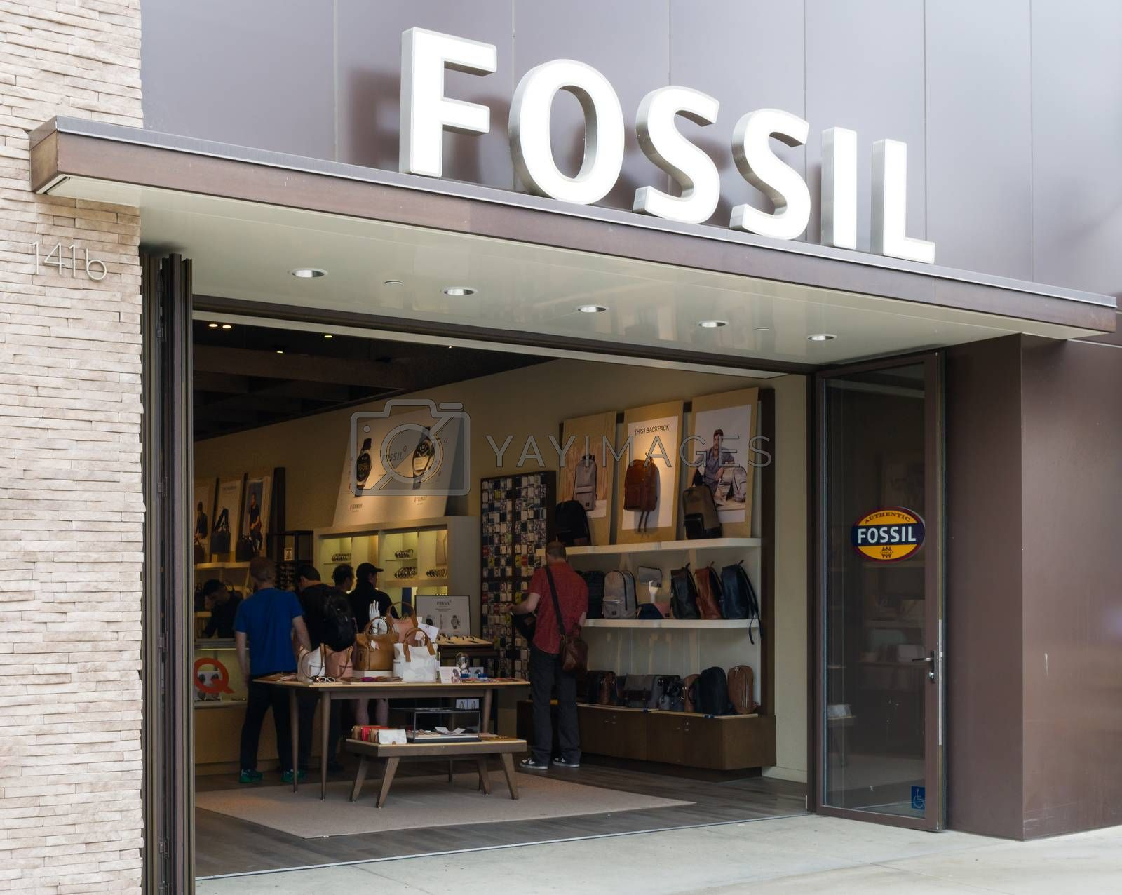 SANTA MONICA, CA/USA - MAY 12, 2016: Fossil store exterior and sign. Fossil Group, Inc. is an American designer and manufacturer of watches, jewelry and accessories.