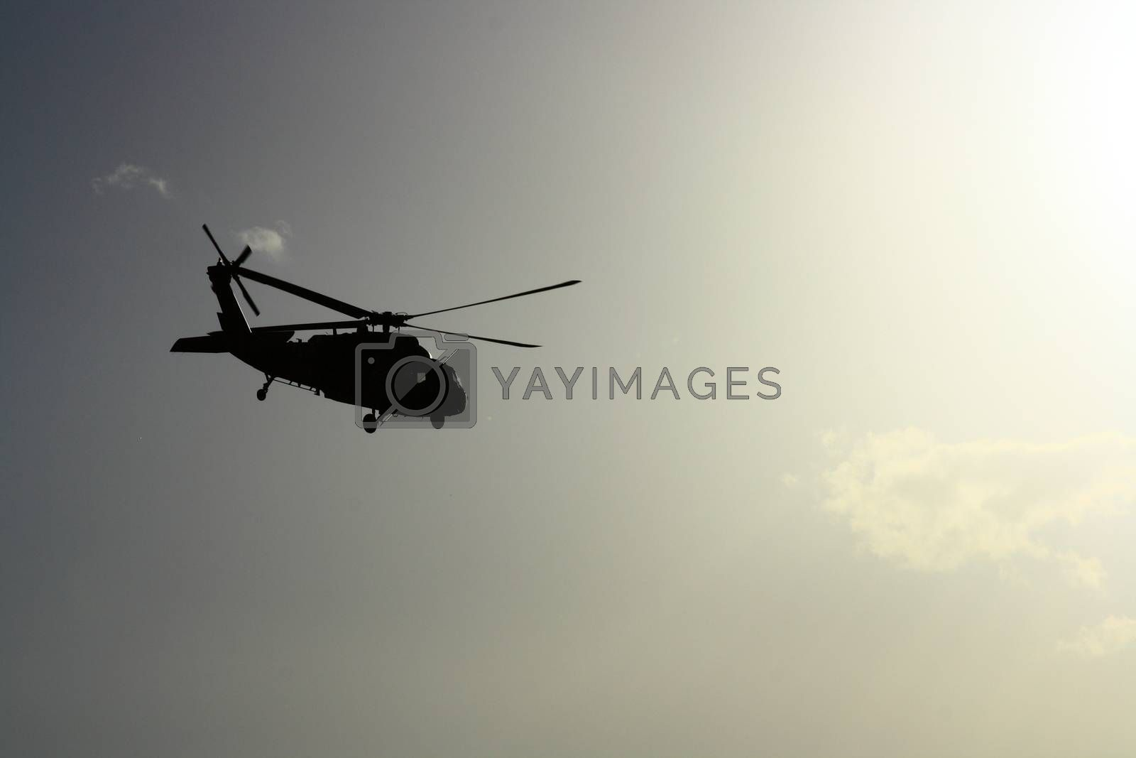 Royalty free image of Helicopter at sunset with sun view by mturhanlar