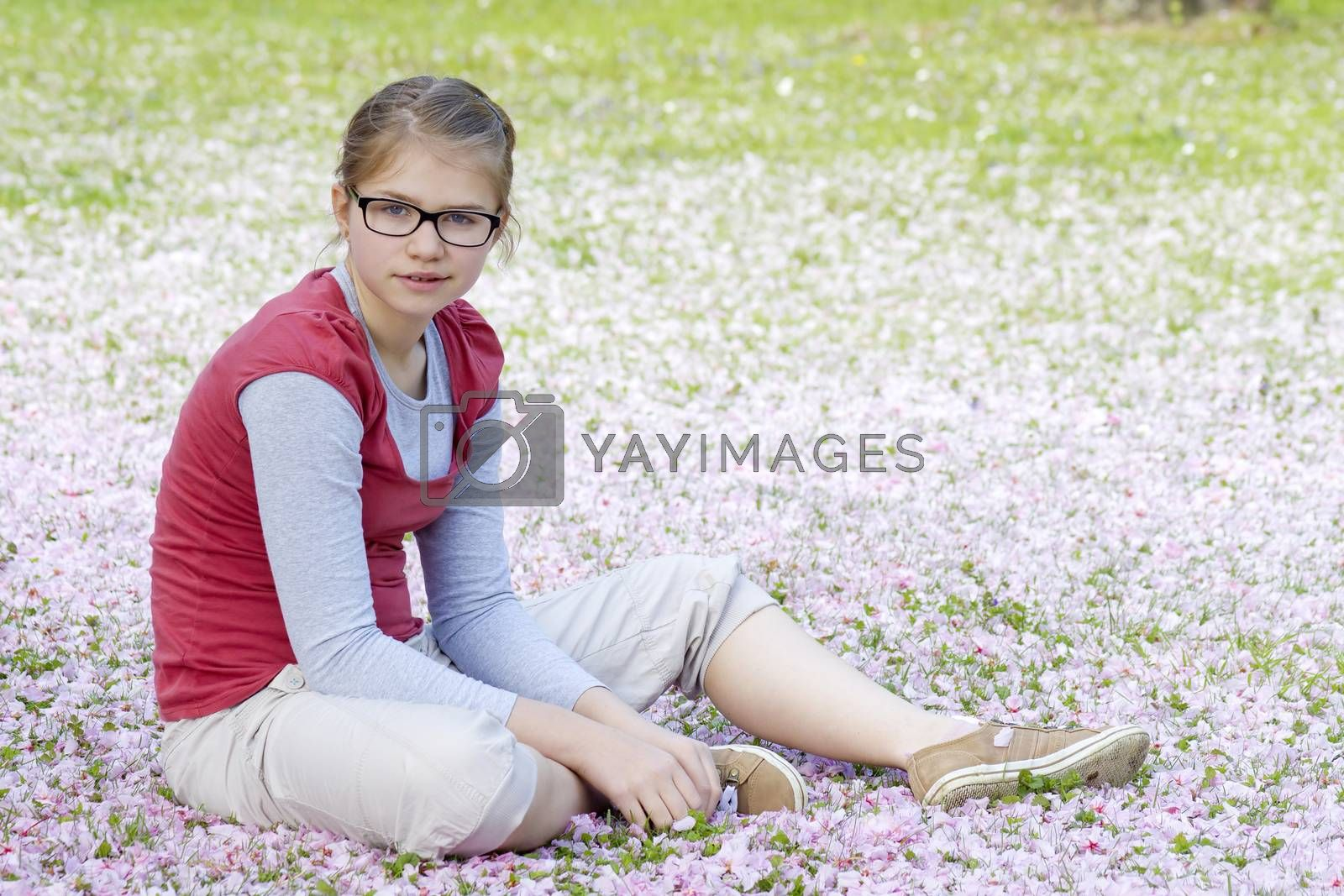 Young girl resting in park in spring day by miradrozdowski