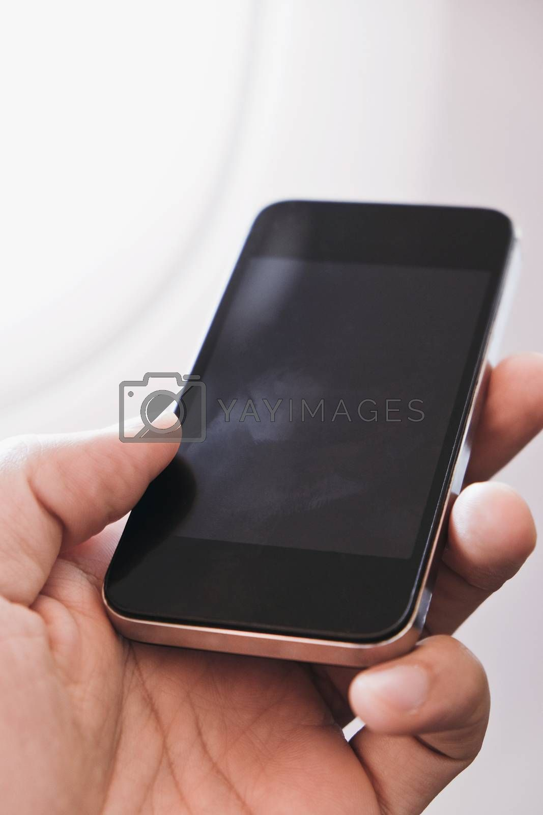 close up of business man siting near airplane window and watching his phone, Business communication