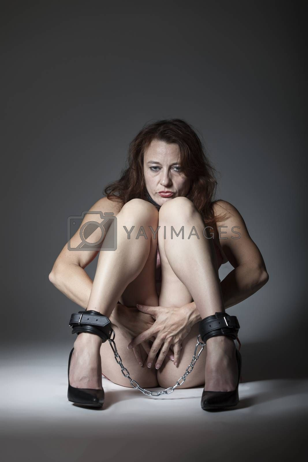 bound woman sitting on the floor
