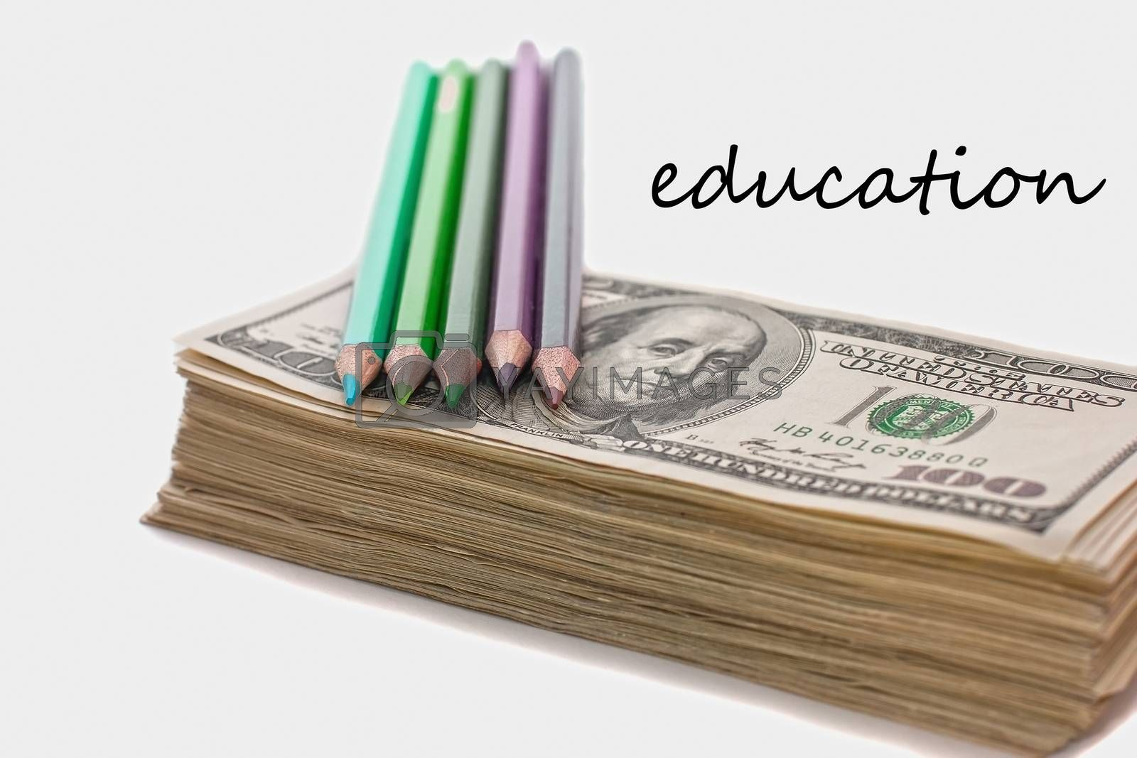 education has a price, the money allocated for education, investment in knowledge, dollars and pencils, scholarship, very soft focus