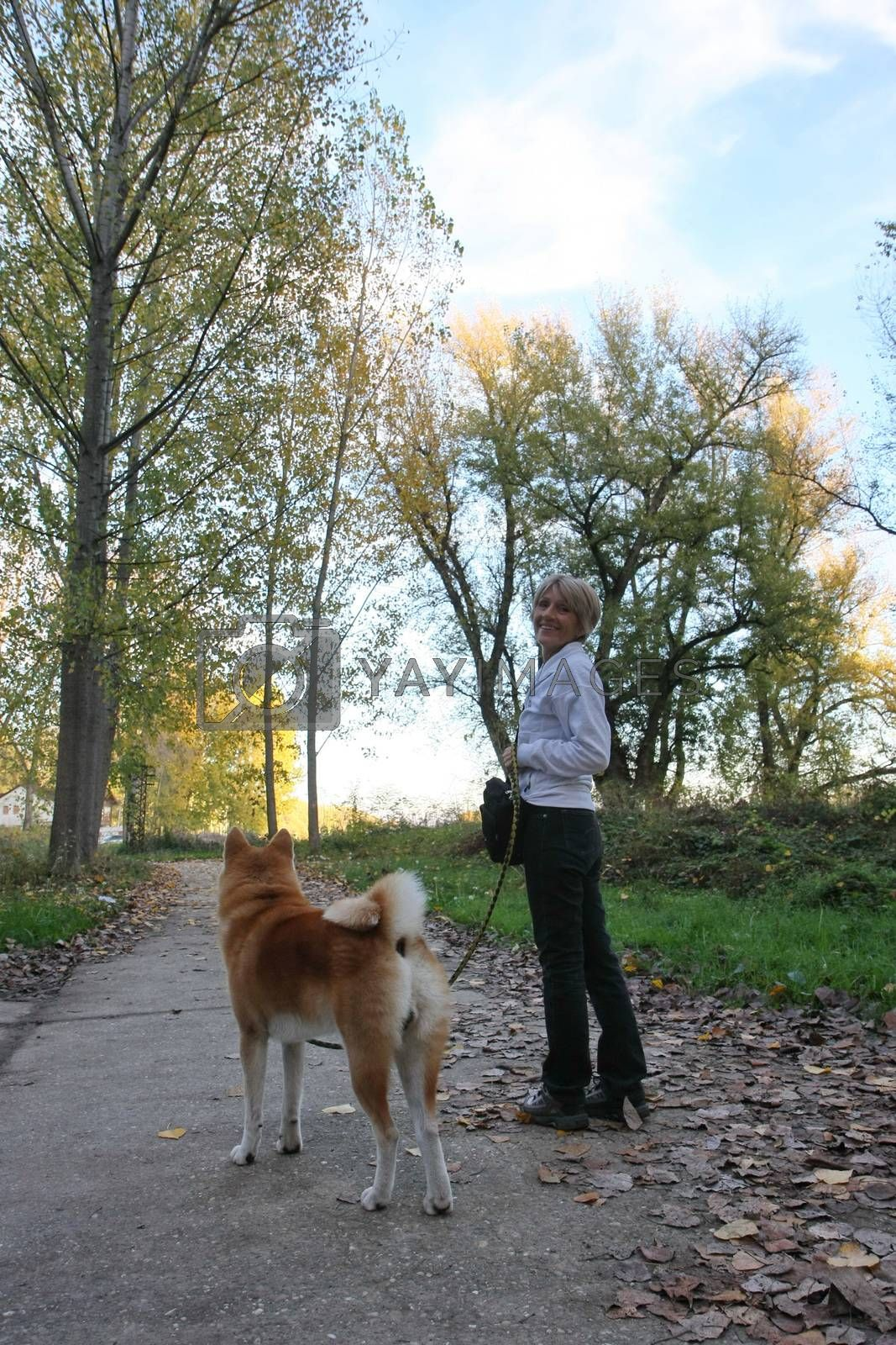 Lady with her dog by tdjoric