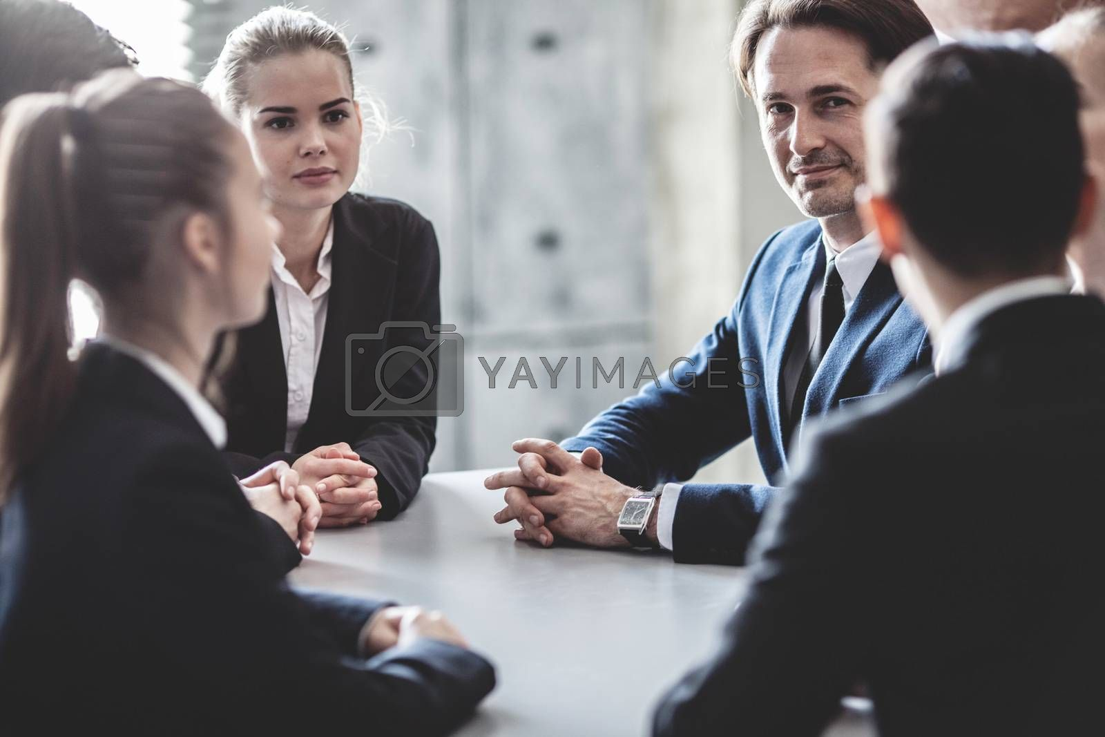 Group of business people working together at meeting in office