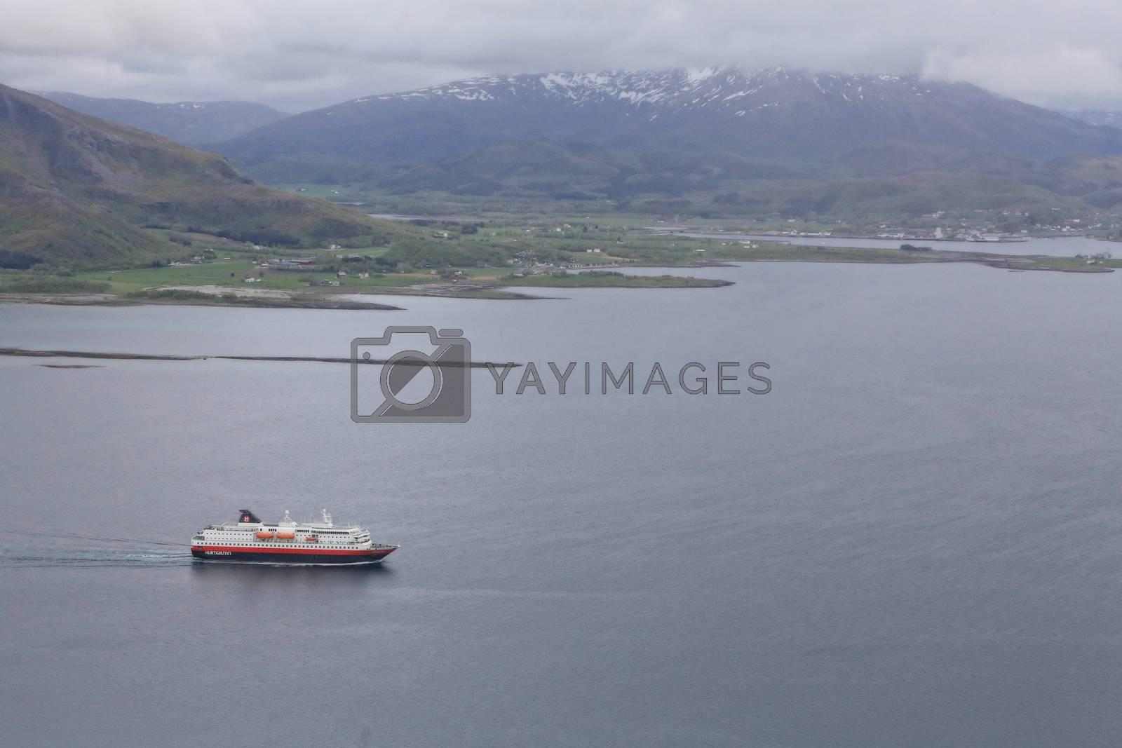 M.s Richard With passerer Torghatten en regntung dag -T att fra toppen av Torghatten