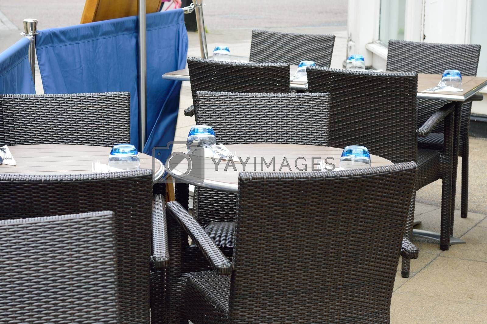 Empty Outdoor Rattan Dining Tables