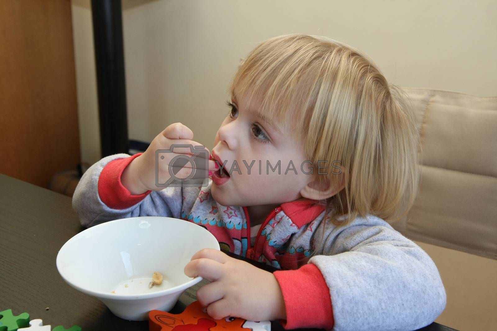Young girl enjoys eating peanuts