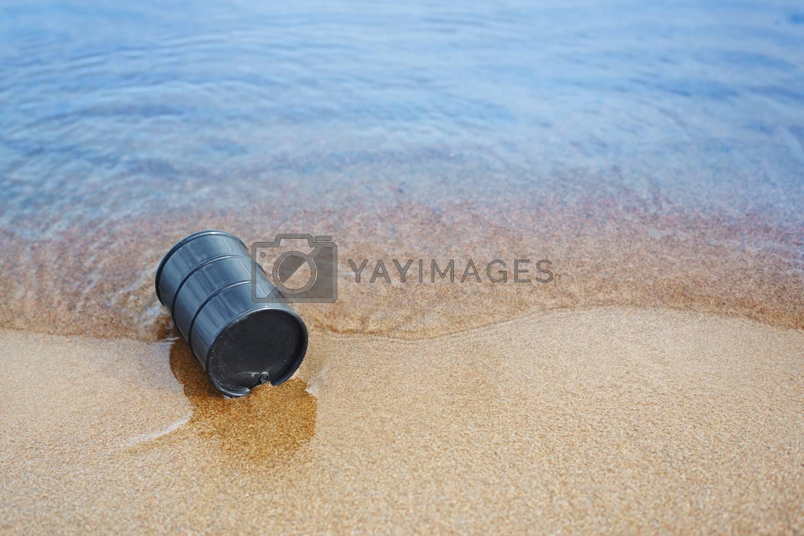 Oil barrel abandoned at the sea coast