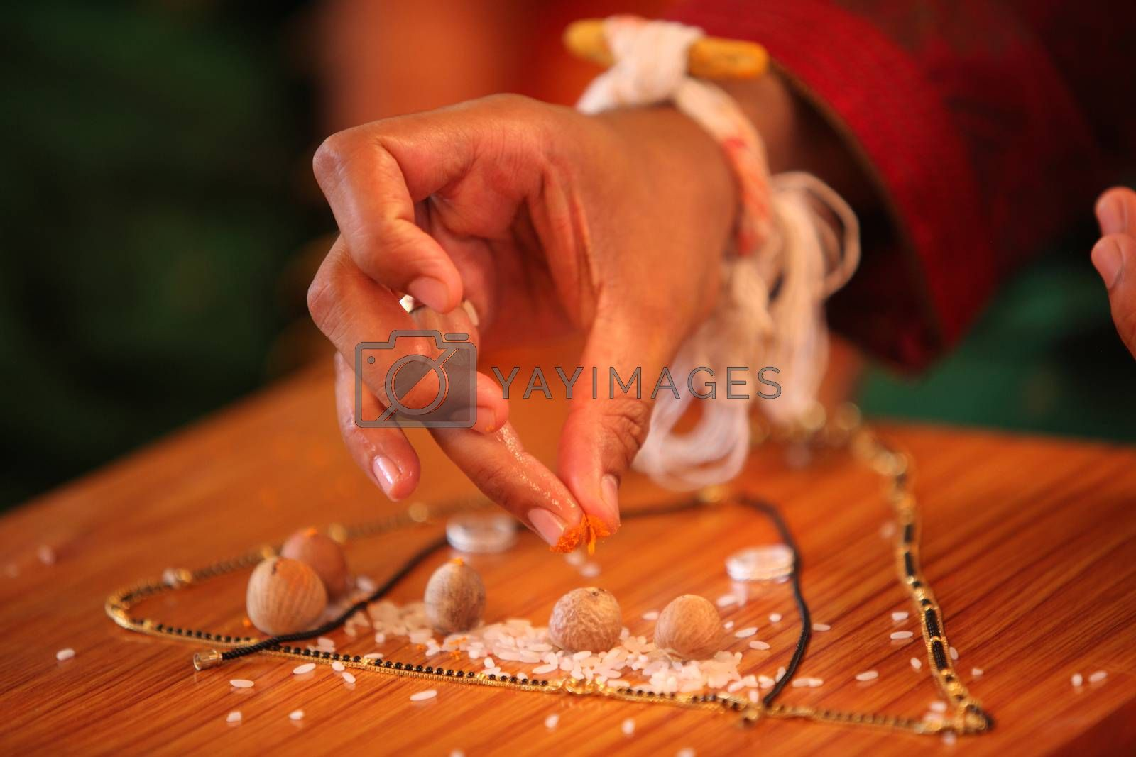 A groom performing a traditional ritual during a hindu wedding in India