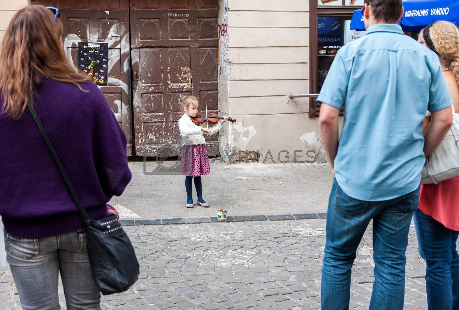 VILNIUS, LITHUANIA - MAY 21, 2016: Young girl playing violin on the street at traditional street music day in Vilnius, Lithuania