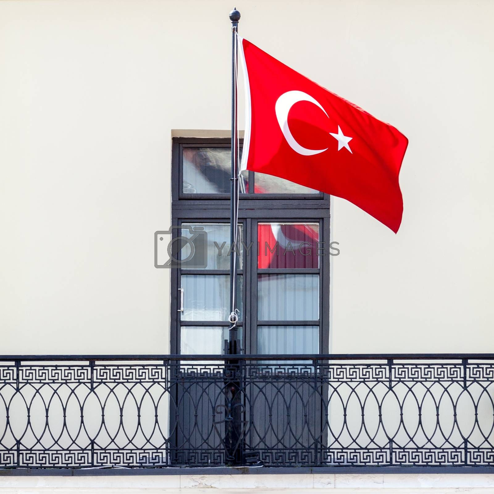 Turkish flag waving in the wind on the balcony