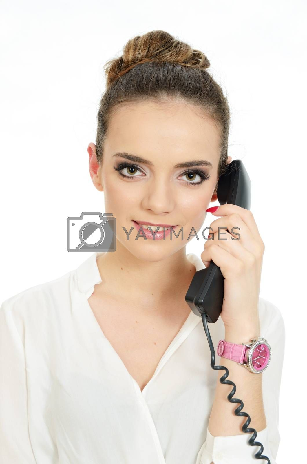 Young girl holding phone in her hand. Neat office lady wearing elegant white blouse.