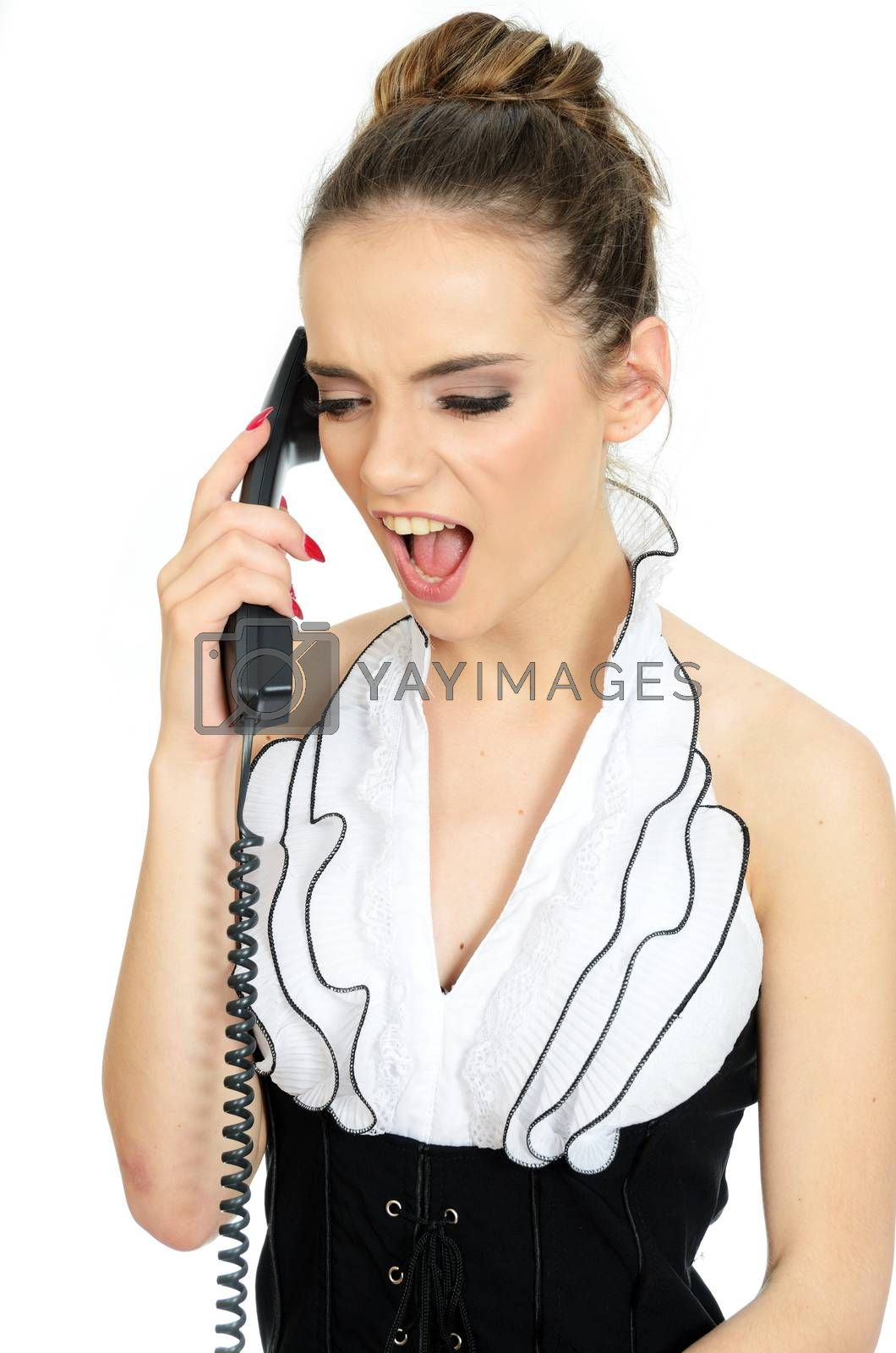 Young office lady screams on phone. Female model holds cable phone in her hand. Angry face expression.