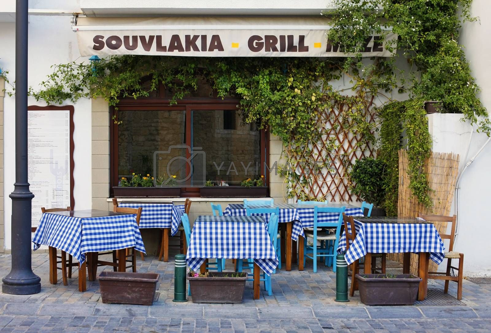 Larnaca, Cyprus - May 23, 2016: Small Street with cafe in Larnaca during Summer. Cuprus