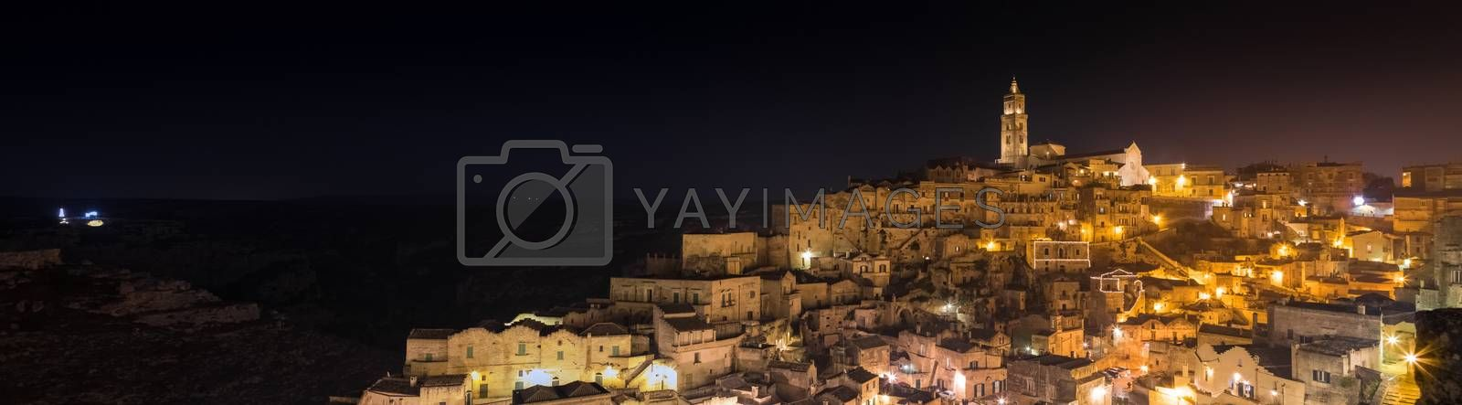panoramic view of typical stones (Sassi di Matera) and church of Matera UNESCO European Capital of Culture 2019  at night