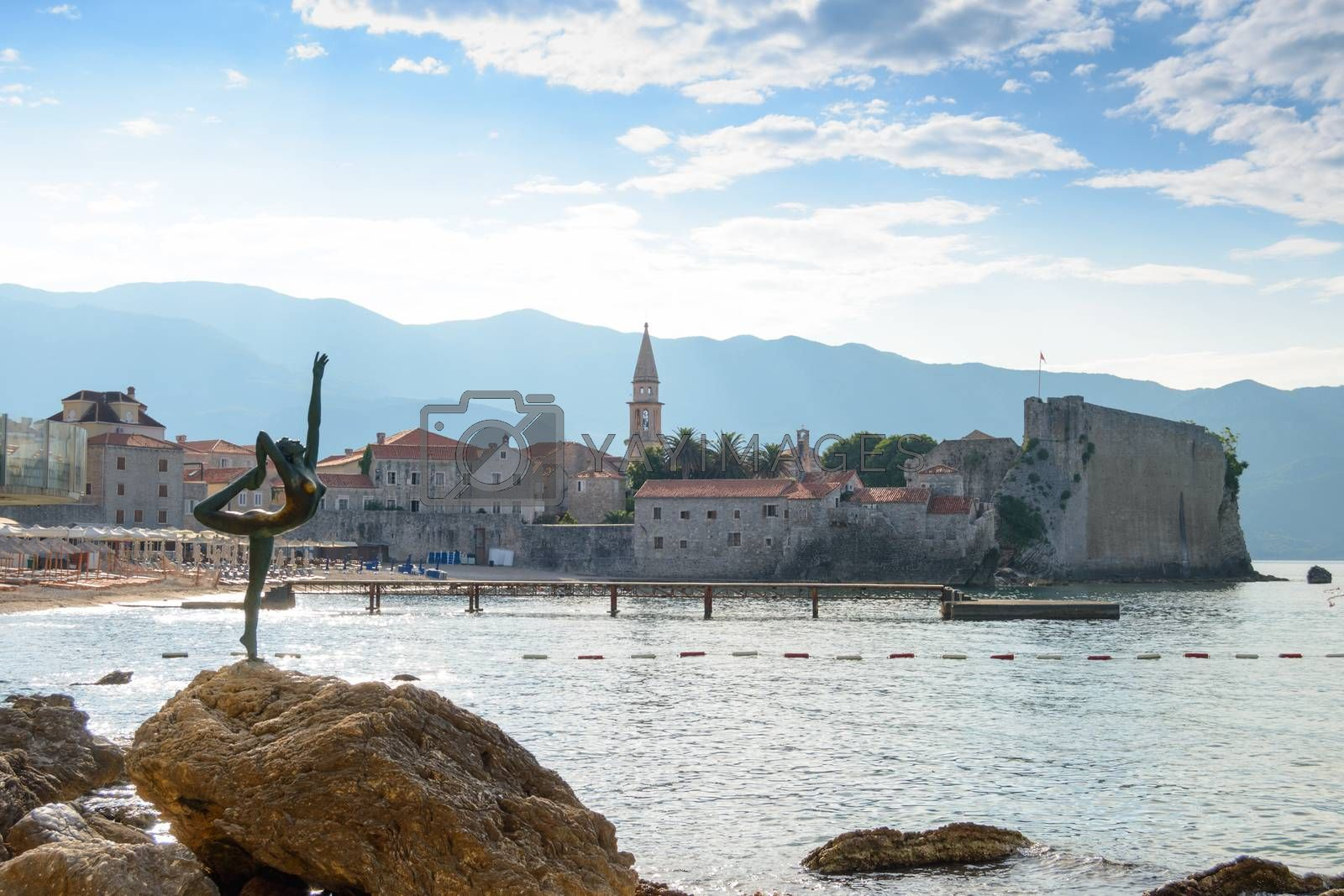 BUDVA, MONTENEGRO - 29 JUNE 2015 - Morning in Old City of Budva and Famous Dancer Statue in front of it