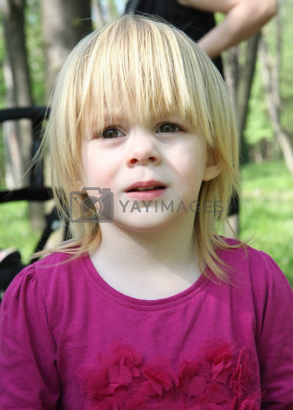 Portrait of young girl posing  in nature