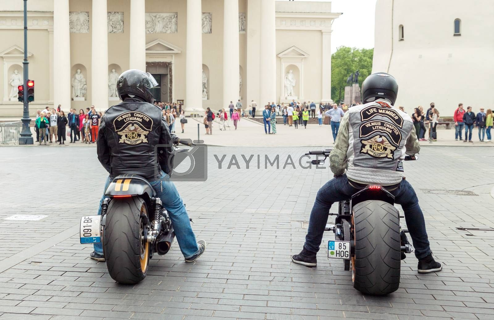 VILNIUS, LITHUANIA - MAY 21, 2016: Two riders sitting on Harley-Davidson bikes and waiting for green light on the street in Vilnius, Lithuania.