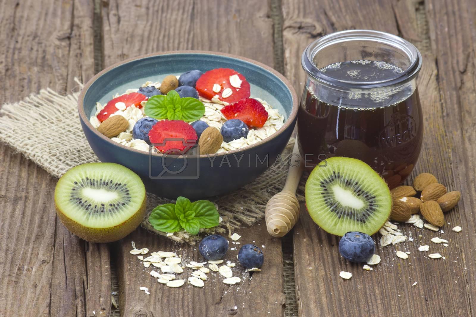 Royalty free image of healthy breakfast - muesli with fruit, yogurt and honey by miradrozdowski