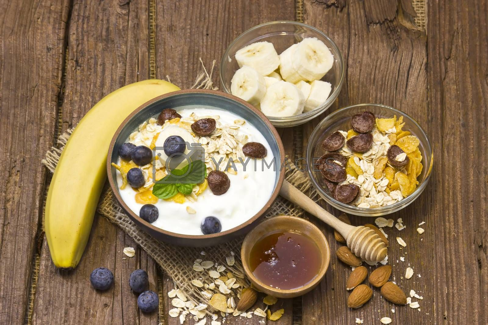 healthy breakfast - muesli with fruit, yogurt and honey