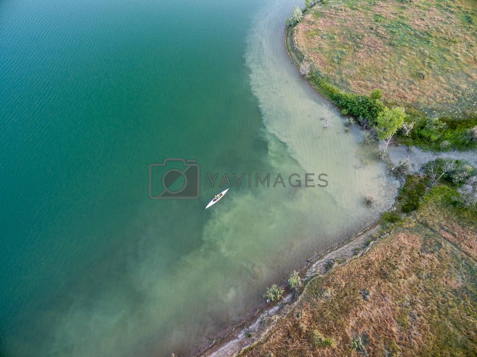 aerial view of a lake with canoe, summer evening in Colorado