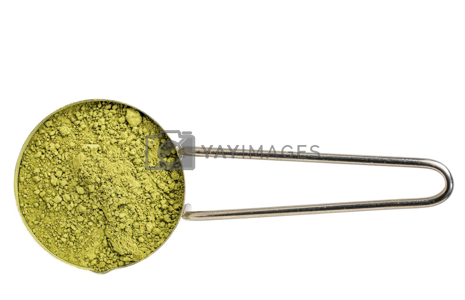 measuring scoop of organic matcha green tea powder isolated on white