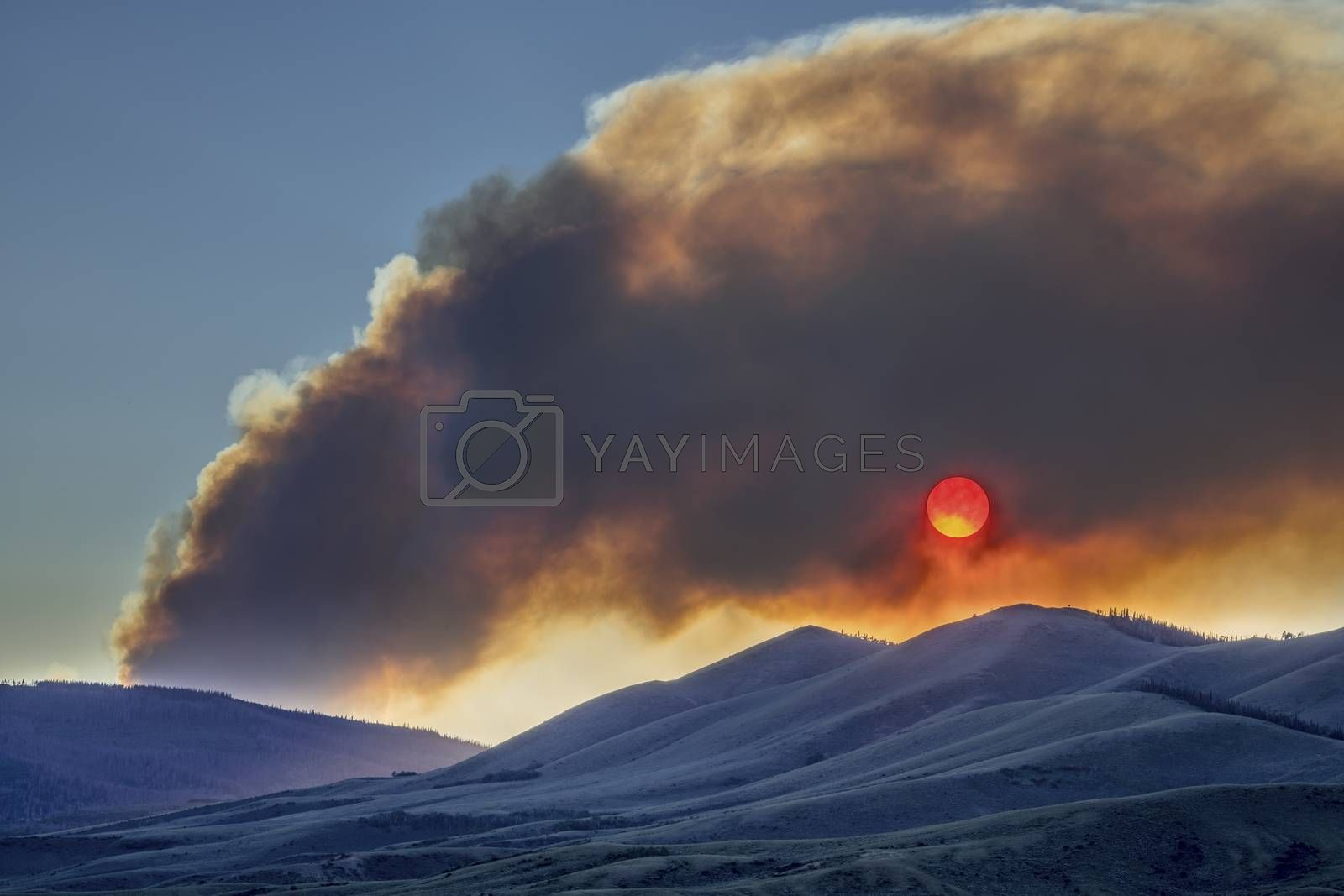 wildfire smoke plume obscuring sunset over mountains - North Park, Colorado