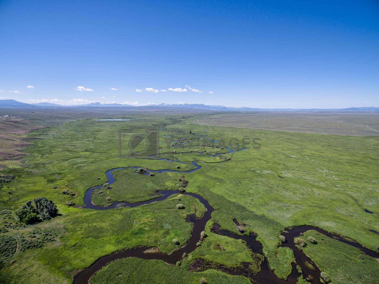 Illinois River meanders through Arapaho National Wildlife Refuge, North Park near Walden, Colorado, early summer aerial view