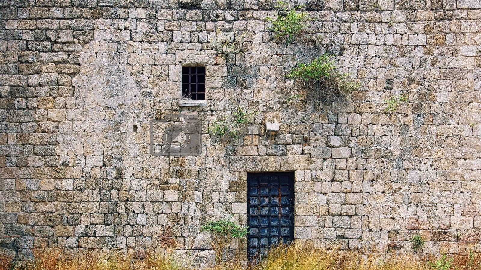 antique wall with the window and the door