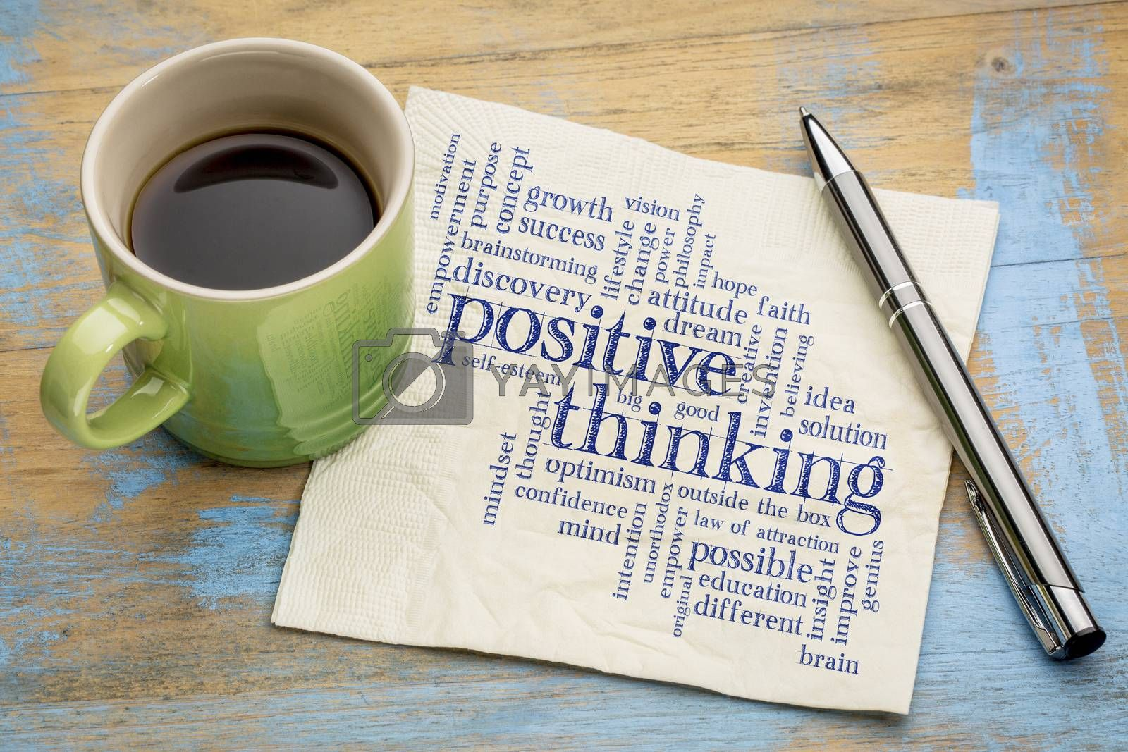 positive thinking word cloud - handwriting on a napkin with a cup of espresso coffee