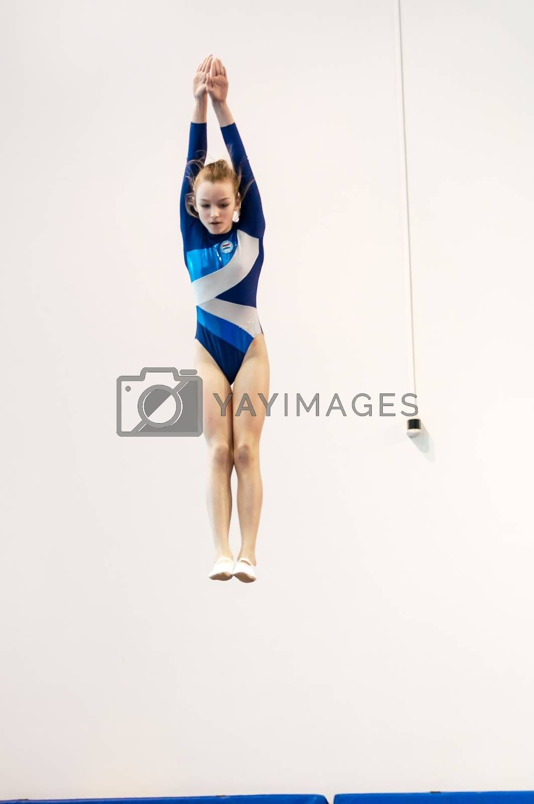 Orenburg, Russia - 19 April 2016: Girls compete in jumping on the trampoline on Championship privolzhskiy district