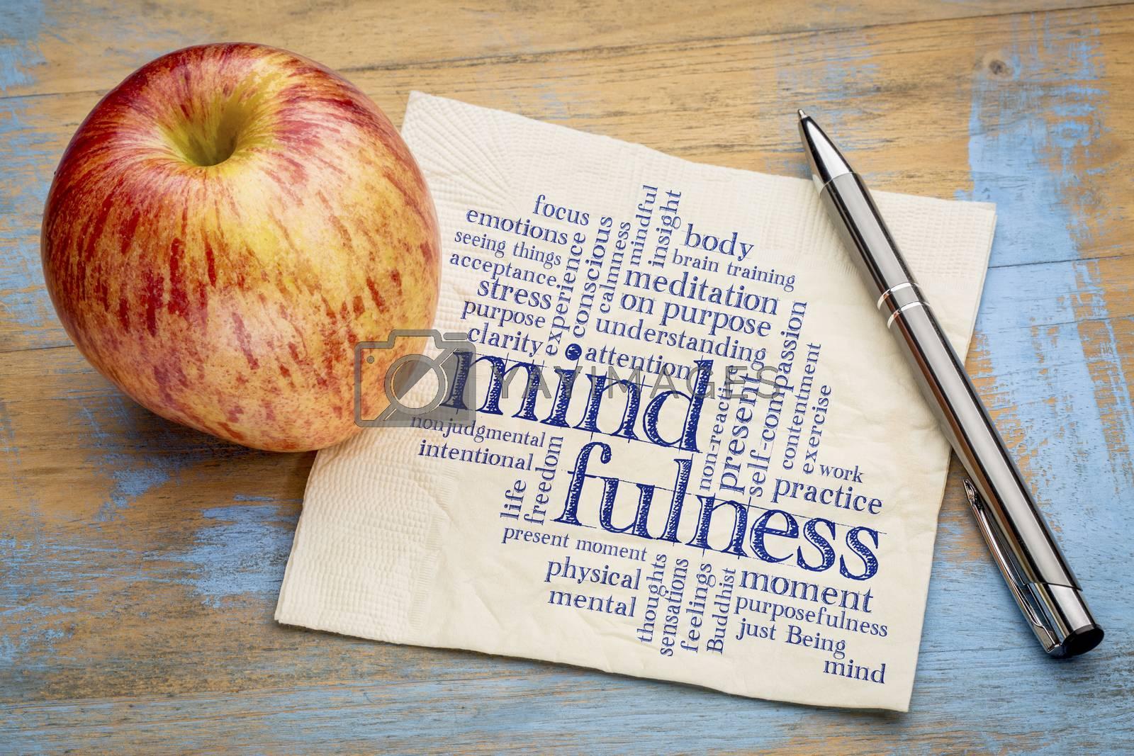 mindfulness word cloud on a napkin with a fresh apple