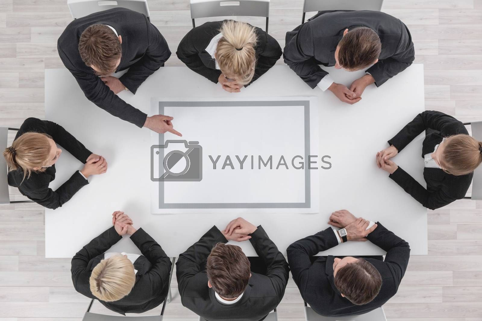 Diverse business people sitting around the table on a meeting