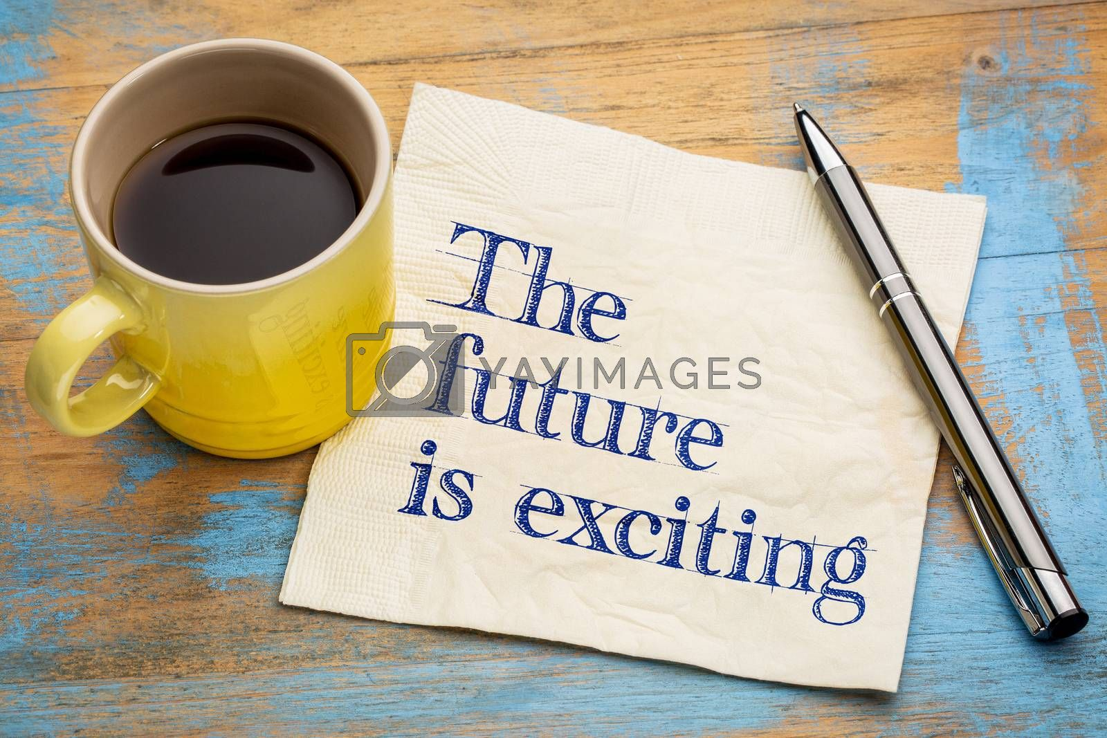 The future is exciting - handwriting on a napkin with a cup of coffee