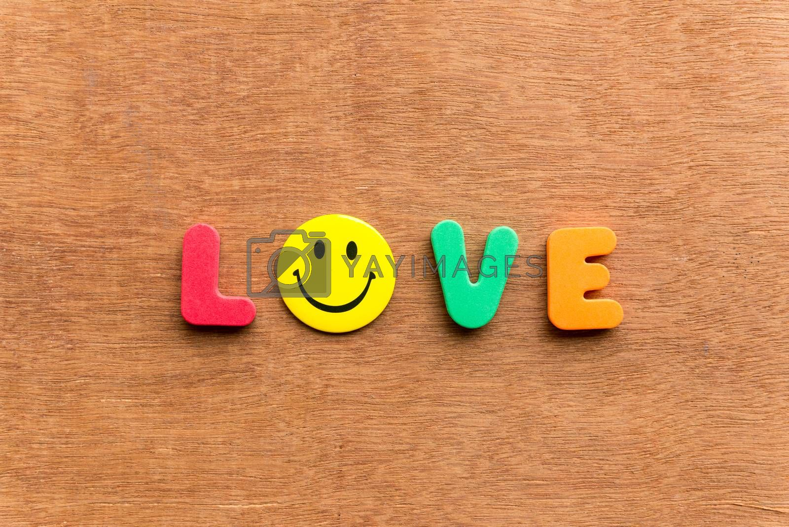 love colorful word on the wooden background