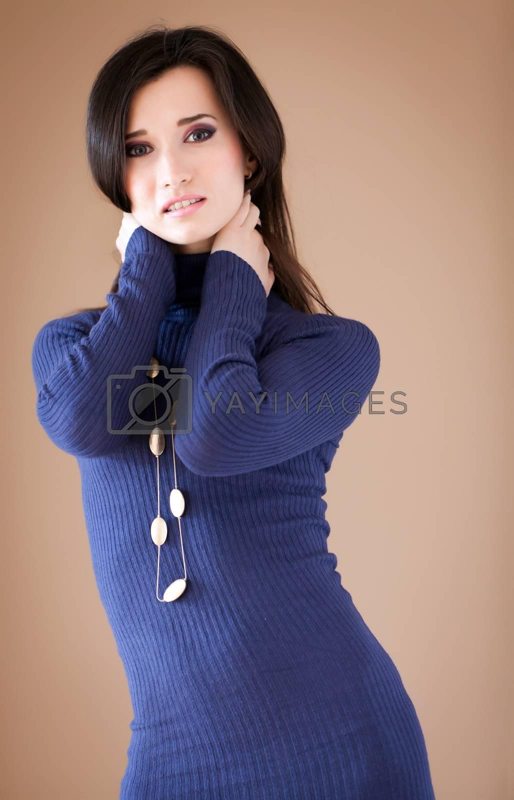 Studio portrait of a lovely brunette posing.