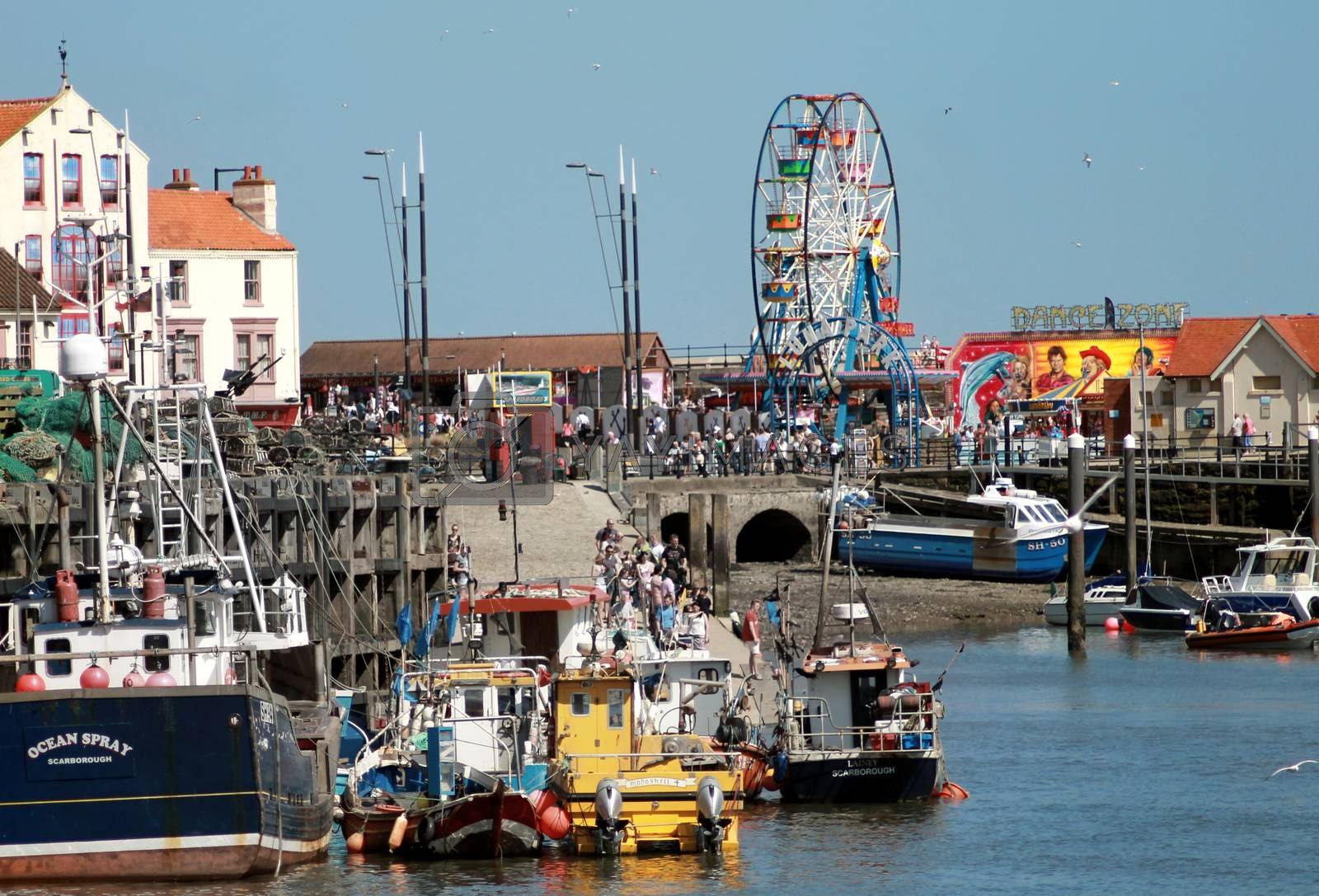 SOUTH BAY HARBOR, SCARBOROUGH, NORTH YORKSHIRE, ENGLAND - 19th of May 2014: Tourists enjoying a day out in Scarborough resort on the 19th of May 2014 This is a popular and tourist destination.