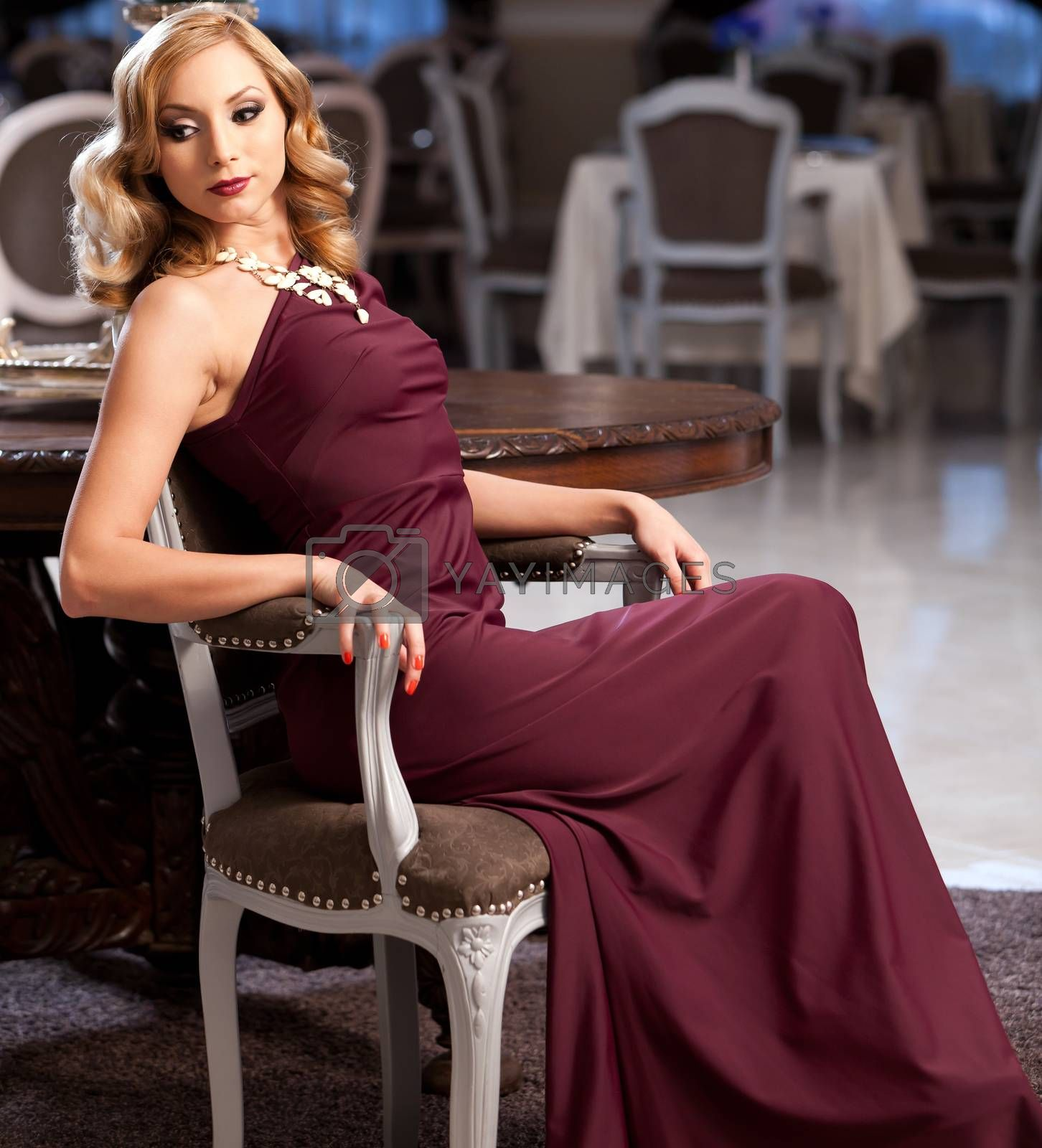 Beautiful blond in an elegant red dress. Please see more images from the same shoot.