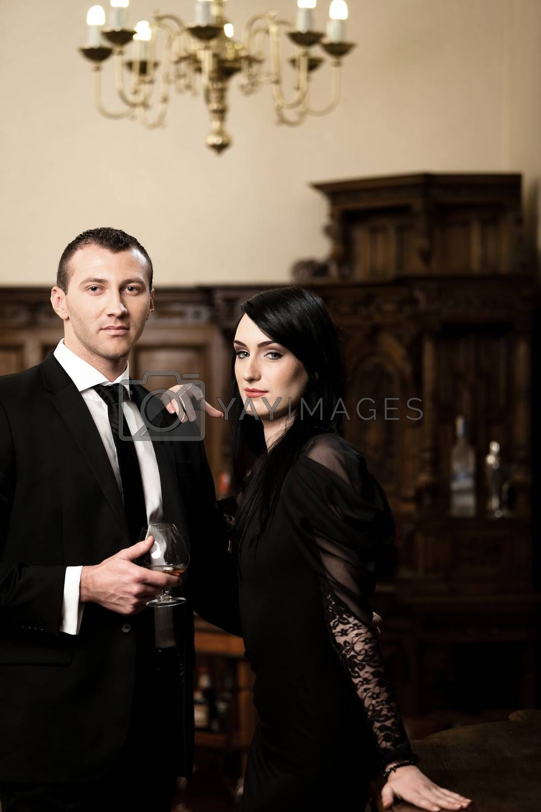 Attractive business couple smiling while is having a drink. Please see more images from the same shoot.