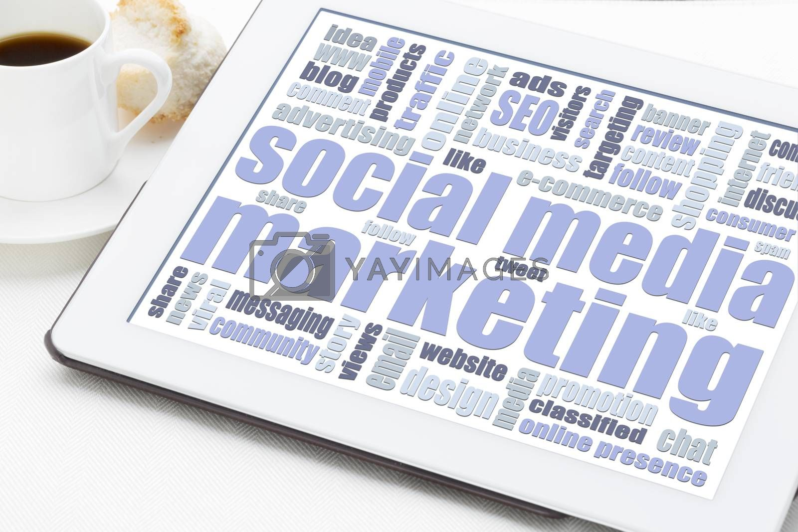 social media marketing concept - a word cloud on a digital tablet with a cup of coffee